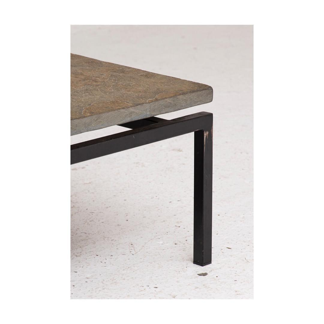 Brutalist coffee table produced in Germany in 1960. Table leaf is one square slab of slate floating on a blackcoated steel frame. In good overall condition with some light wear from a previous life.
