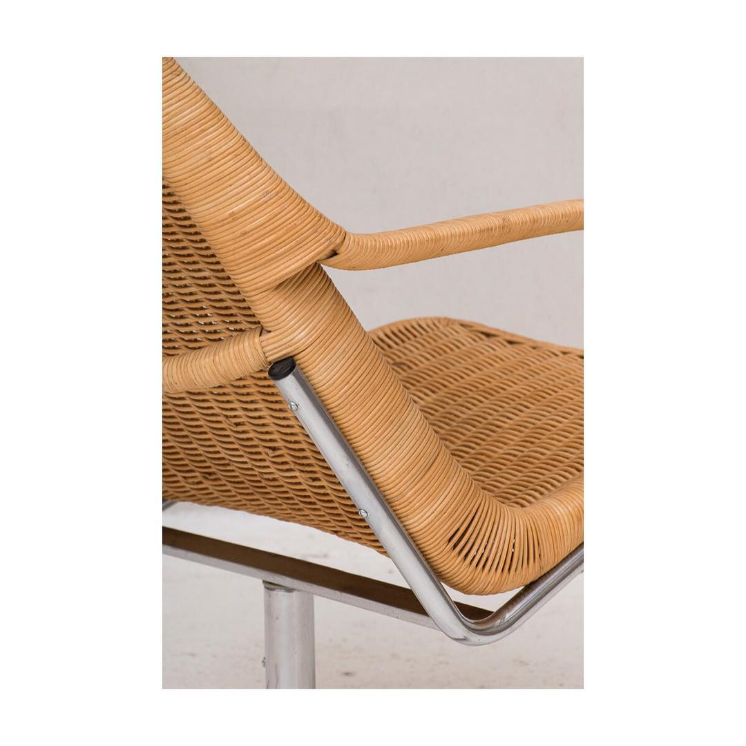 Swivel chair designed by Dirk van Sliedregt and produced in the Netherlands around 1960. Chrome frame with a seating in bamboo and rattan. In good condition.